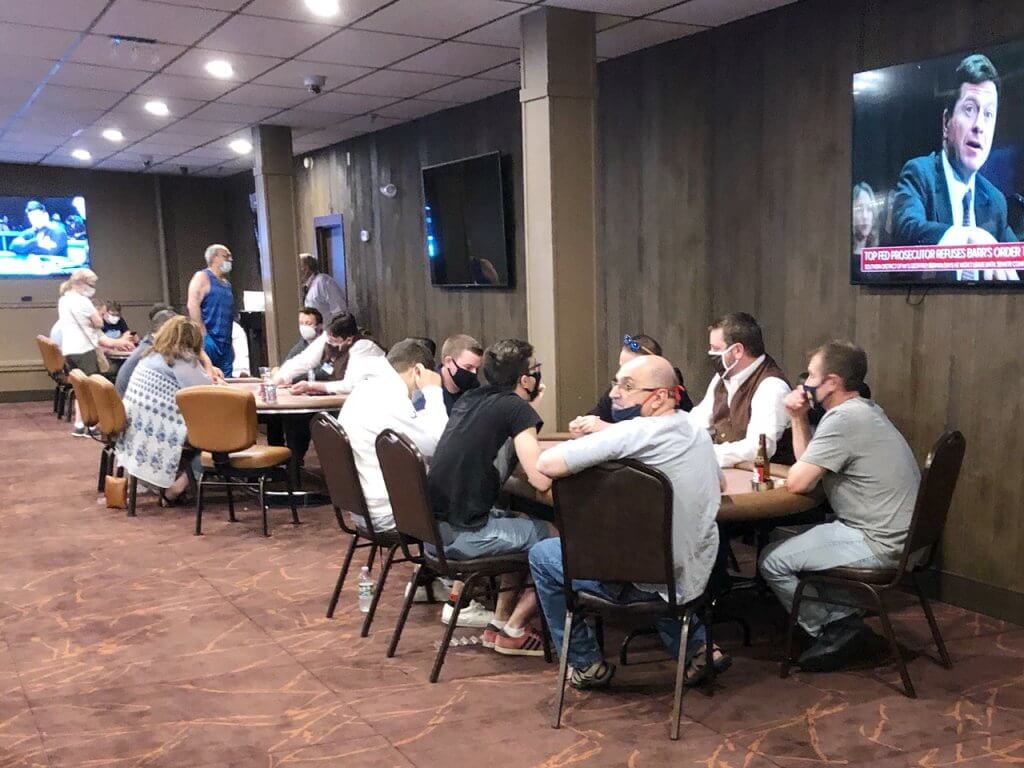 Players with Masks Play Live Poker